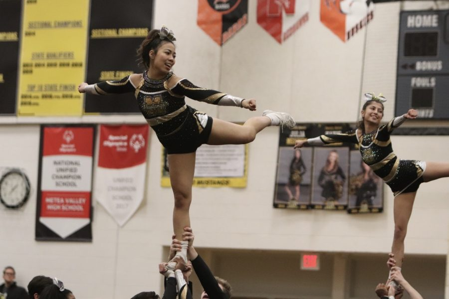 Varsity cheer shows off their routine.