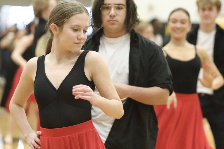 Senior Chloe Beach performs with Orchesis.