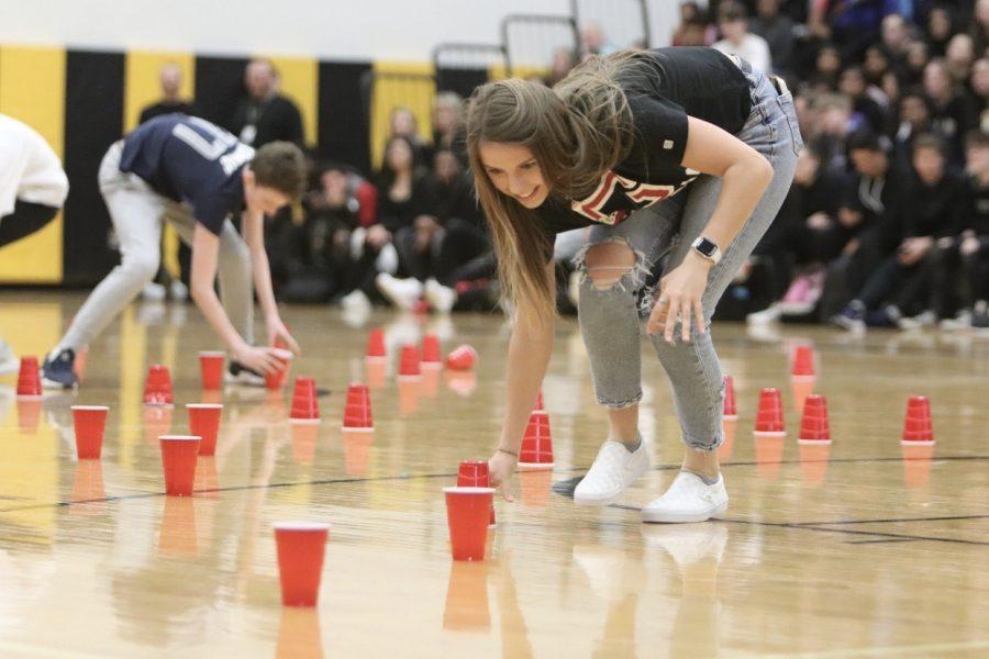 Senior Sydney Rohm participates in the flip cup game.