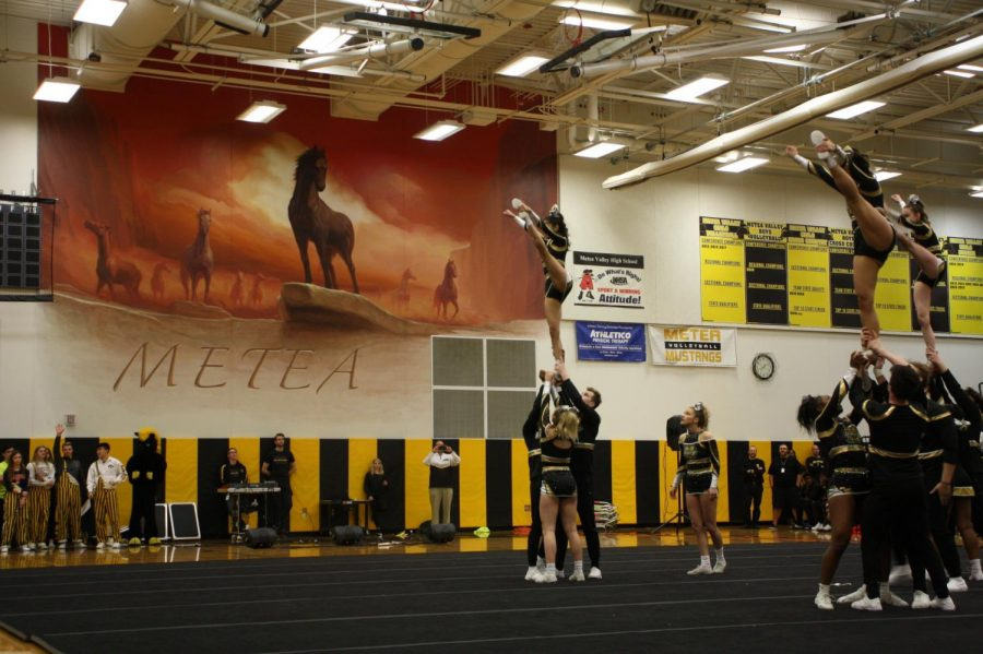 Cheerleading performs featuring former football players.