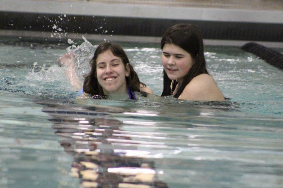 Senior Kirsten Dullnigg and Emma Gatz participate in assisted swim.