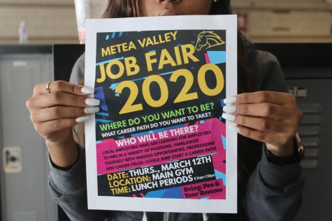 Posters advertising the job fair hope to attract interested students.