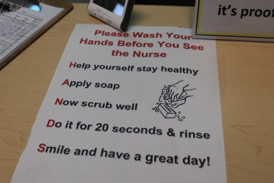 Signs have been put up around the school to prevent the spread of sickness.