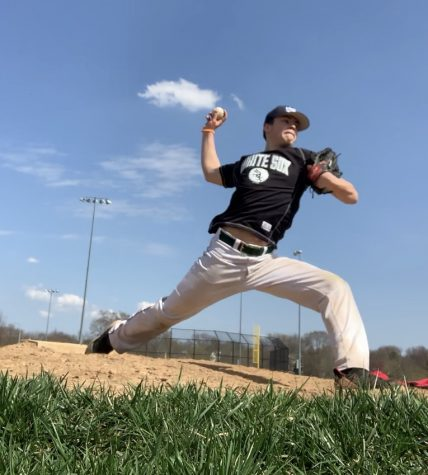 Vlad Hudson enjoying the sun while improving on his pitching speed and accuracy.