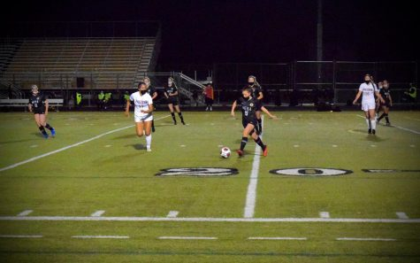 Kaylee Bannack defends goal against Wheaton North game last night in Mustang Stadium.