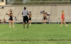The girls' lacrosse team wins against Naperville Central convincingly, 19-8.