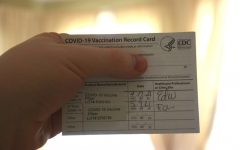 A standard-issued COVID-19 vaccination record card.