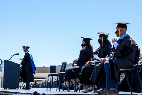 Teachers take a moment to glance at the senior class and celebrate their accomplishments.