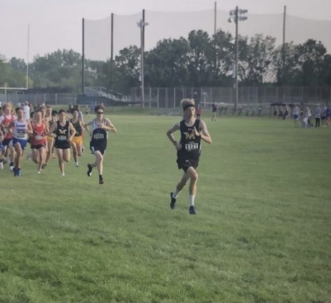 Senior Ben Lamsma taking off from the starting line at the Aurora City Meet.