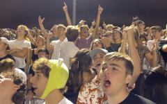 Seniors create chants to cheer on Metea Valleys varsity football.