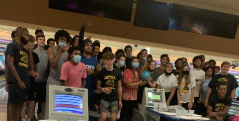Mustangs girls bowling teaches boys football the ropes of their sport at Fox Bowl last Monday.