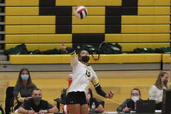 Kira Hutson jumps for a spike during volleyball game against Waubonsie Valley last Tuesday.